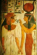 An Egyptian deity hands the Ankh symbol